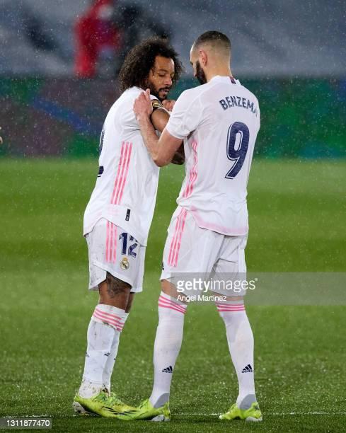 Karim Benzema of Real Madrid puts the captains armband on Marcelo during the La Liga Santander match between Real Madrid and FC Barcelona at Estadio...