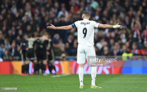 Karim Benzema of Real Madrid reacts after Ajax scored their 4th goal during the UEFA Champions League Round of 16 Second Leg match between Real...
