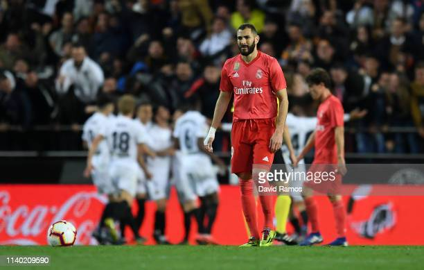 Karim Benzema of Real Madrid reacts after his side concede a goal during the La Liga match between Valencia CF and Real Madrid CF at Estadio Mestalla...