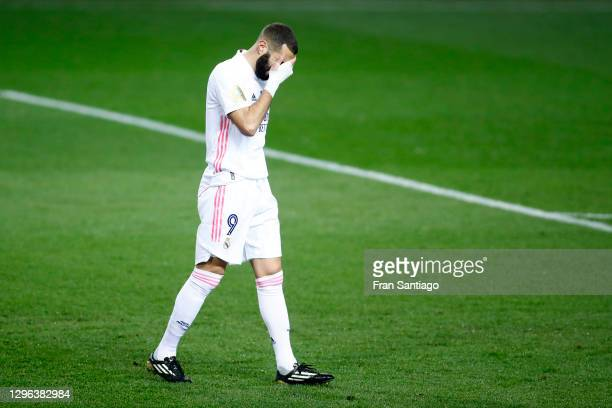 Karim Benzema of Real Madrid reacts after his side concede their first goal during the Supercopa de Espana Semi Final match between Real Madrid and...