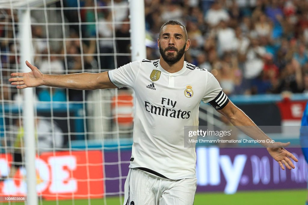Karim Benzema #9 of Real Madrid reacts after scoring a goal against Manchester United in the first half of the International Champions Cup at Hard Rock Stadium on July 31, 2018 in Miami, Florida.