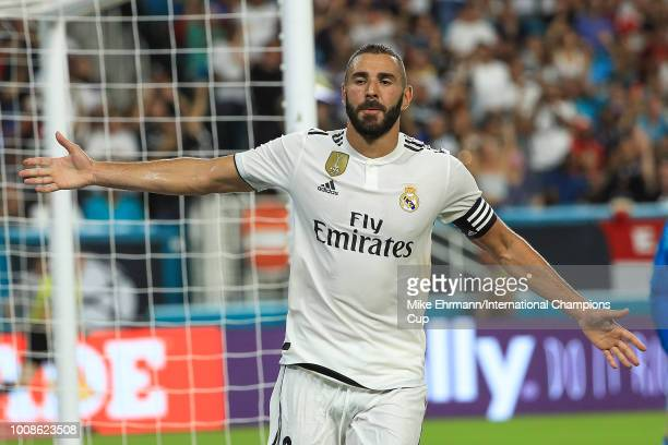Karim Benzema of Real Madrid reacts after scoring a goal against Manchester United in the first half of the International Champions Cup at Hard Rock...