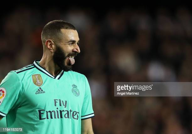 Karim Benzema of Real Madrid reacts during the Liga match between Valencia CF and Real Madrid CF at Estadio Mestalla on December 15 2019 in Valencia...