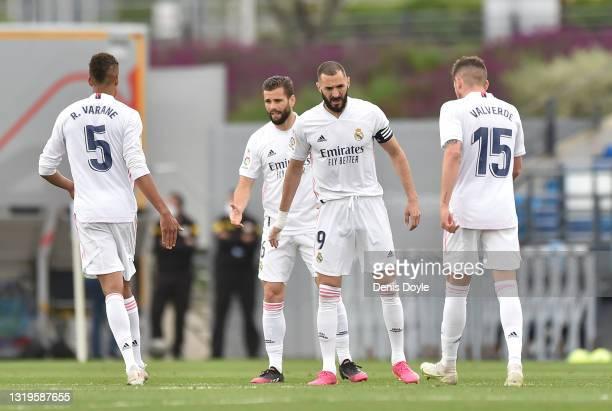 Karim Benzema of Real Madrid reacts with team mates Raphael Varane, Nacho Fernandez and Federico Valverde at the end of the La Liga Santander match...