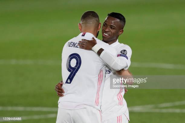 Karim Benzema of Real Madrid, Rodrygo of Real Madrid Celebrating the victory during the UEFA Champions League match between Real Madrid v...