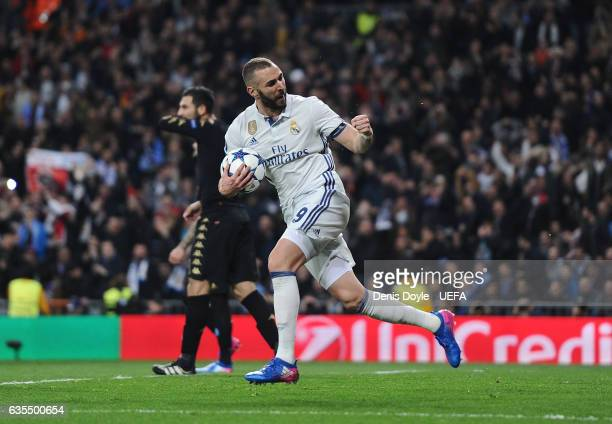 Karim Benzema of Real Madrid runs back after scoring Real's 1st goal during the UEFA Champions League Round of 16 first leg match between Real Madrid...
