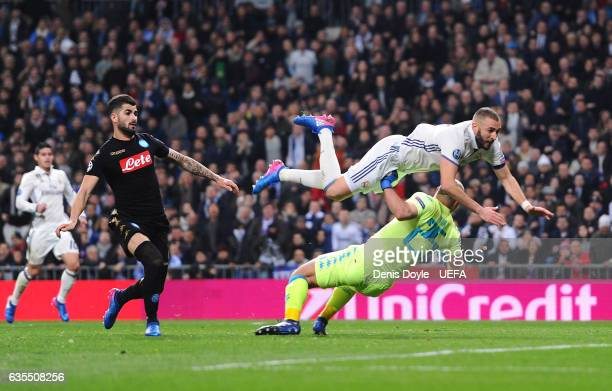 Karim Benzema of Real Madrid runs into Pepe Reina of SSC Napoli during the UEFA Champions League Round of 16 first leg match between Real Madrid CF...