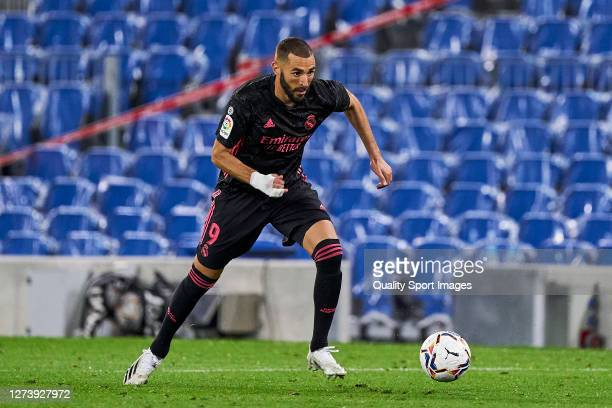 Karim Benzema of Real Madrid runs with the ball during the La Liga Santader match between Real Sociedad and Real Madrid at Estadio Anoeta on...