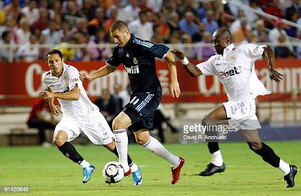 Karim Benzema of Real Madrid runs with the ball during the La Liga match between Sevilla and Real Madrid at Estadio Ramon Sanchez Pizjuan on October...