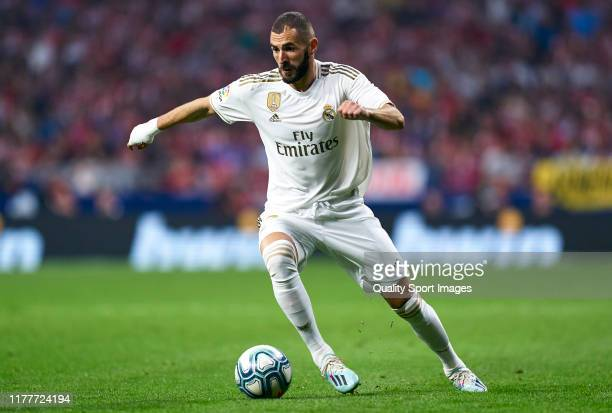 Karim Benzema of Real Madrid runs with the ball during the Liga match between Club Atletico de Madrid and Real Madrid CF at Wanda Metropolitano on...
