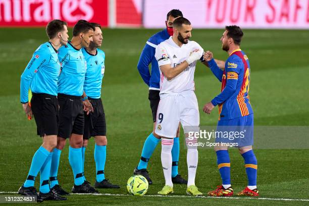 Karim Benzema of Real Madrid salutes with Lionel Messi of FC Barcelona prior the game during the La Liga Santander match between Real Madrid and FC...
