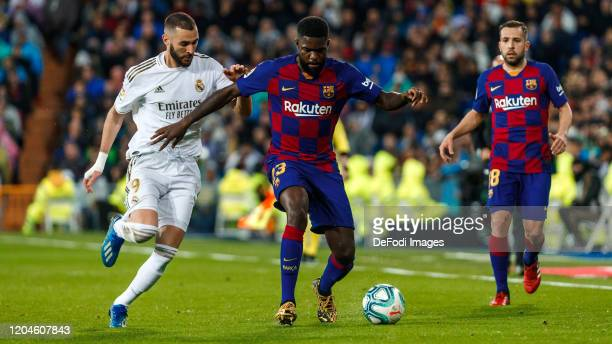 Karim Benzema of Real Madrid Samuel Umtiti of FC Barcelona battle for the ball during the Liga match between Real Madrid CF and FC Barcelona at...