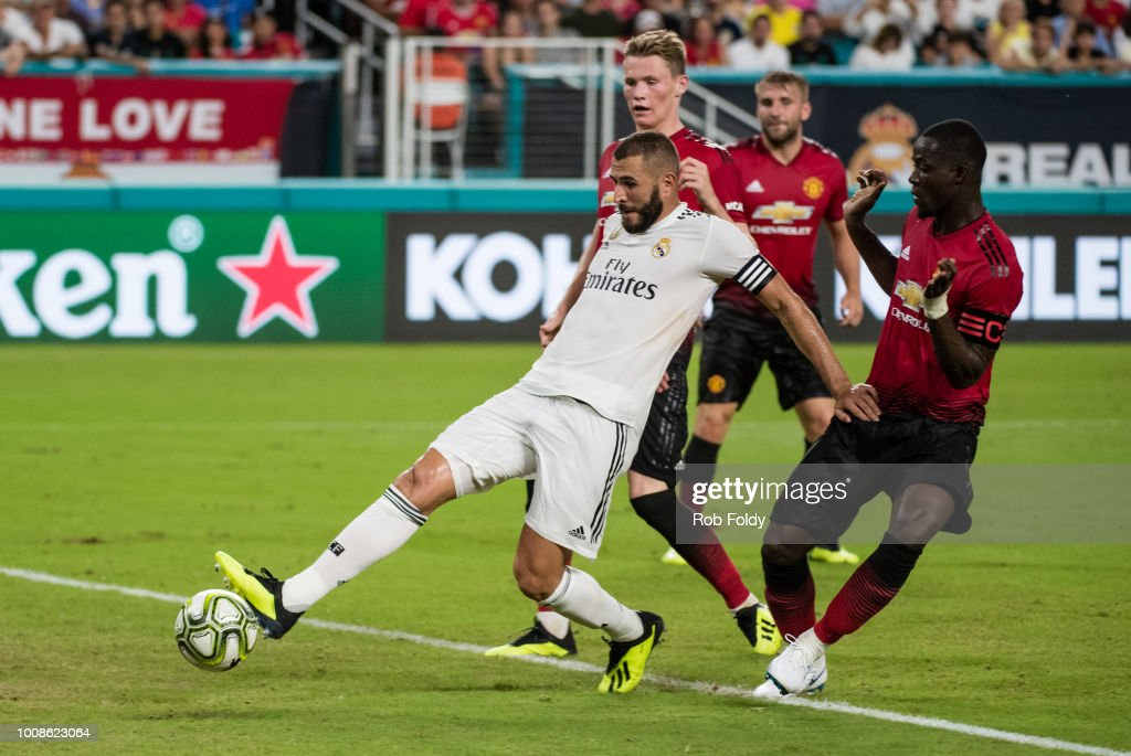 Karim Benzema #9 of Real Madrid scores a goal during the first half of the International Champions Cup match against Manchester United at Hard Rock Stadium on July 31, 2018 in Miami, Florida.
