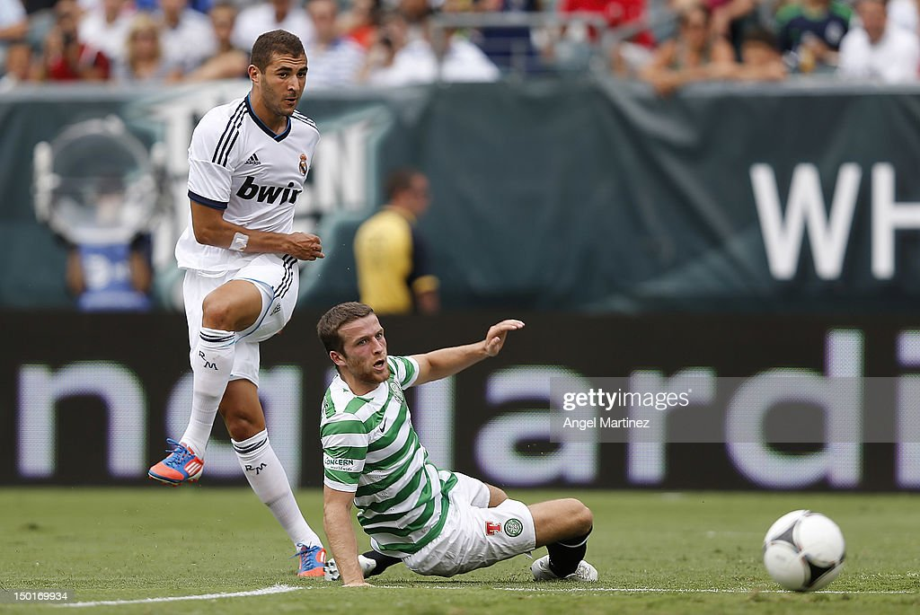 Karim Benzema of Real Madrid scores a goal past Adam Matthews of Celtic during a World Football Challenge match between Celtic and Real Madrid at at Lincoln Financial Field on August 11, 2012 in Philadelphia, Pennsylvania.