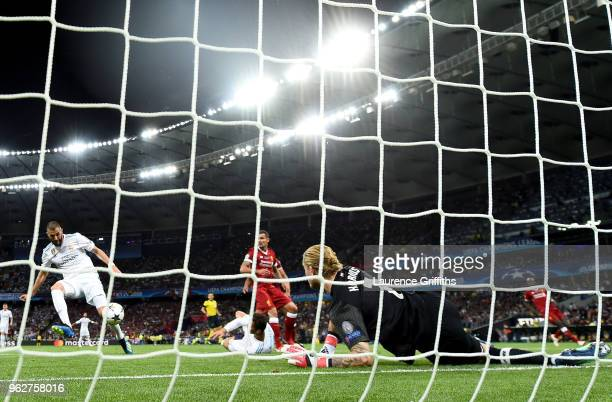 Karim Benzema of Real Madrid scores his sides first goal past Loris Karius of Liverpool which is then disallowed for being offside during the UEFA...