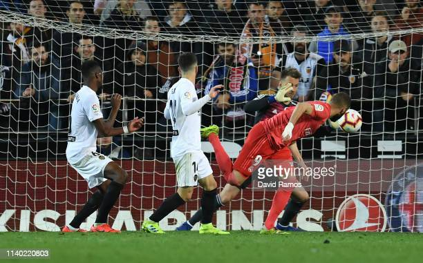 Karim Benzema of Real Madrid scores his side's first goal past Neto of Valencia during the La Liga match between Valencia CF and Real Madrid CF at...