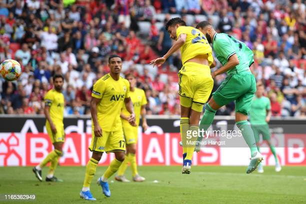 Karim Benzema of Real Madrid scores his sides second goal during the Audi cup 2019 3rd place match between Real Madrid and Fenerbahce at Allianz...