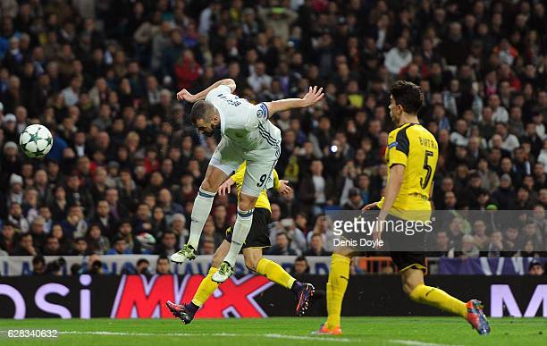 Karim Benzema of Real Madrid scores his sides second goal with his head during the UEFA Champions League Group F match between Real Madrid CF and...