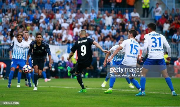Karim Benzema of Real Madrid scores his sides seond goal during the La Liga match between Malaga and Real Madrid at La Rosaleda Stadium on May 21...