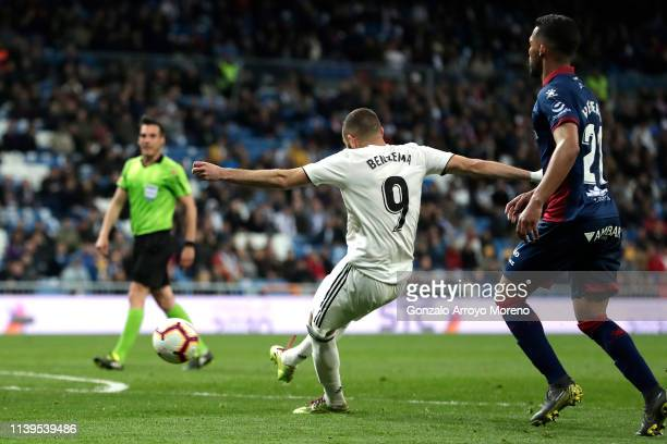 Karim Benzema of Real Madrid scores his sides third goal during the La Liga match between Real Madrid CF and SD Huesca at Estadio Santiago Bernabeu...