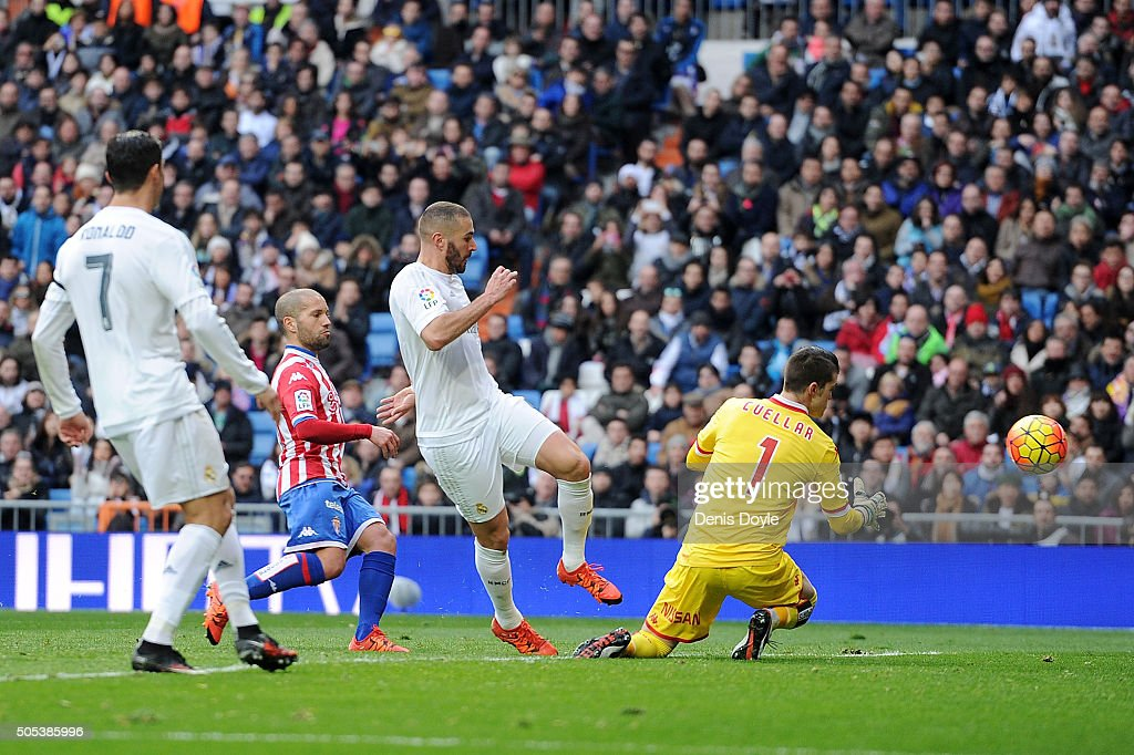 Karim Benzema of Real Madrid scores his team's 5th goal during the La Liga match between Real Madrid CF and Sporting Gijon at Estadio Santiago Bernabeu on January 17, 2016 in Madrid, Spain.