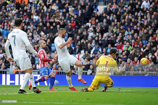 Karim Benzema of Real Madrid scores his team's 5th goal during the La Liga match between Real Madrid CF and Sporting Gijon at Estadio Santiago...