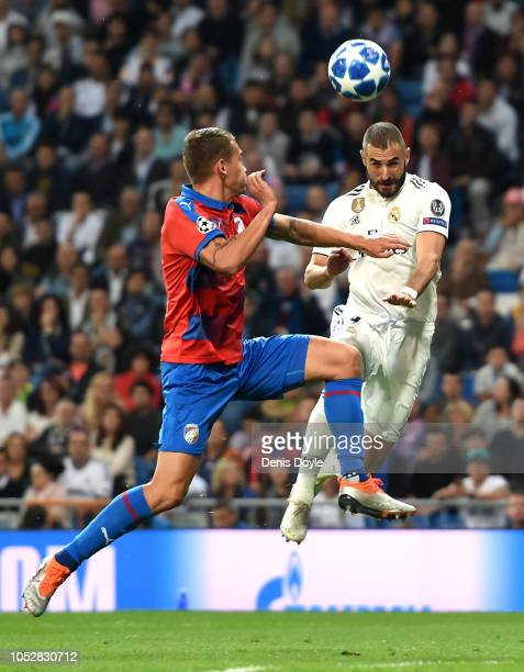 Karim Benzema of Real Madrid scores his team's first goal during the Group G match of the UEFA Champions League between Real Madrid and Viktoria...