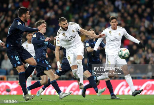 Karim Benzema of Real Madrid scores his team's first goal during the La Liga match between Real Madrid CF and Real Sociedad at Estadio Santiago...