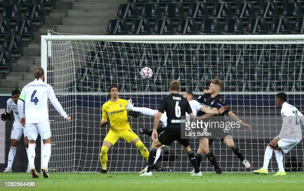 Karim Benzema of Real Madrid scores his team's first goal during the UEFA Champions League Group B stage match between Borussia Moenchengladbach and...