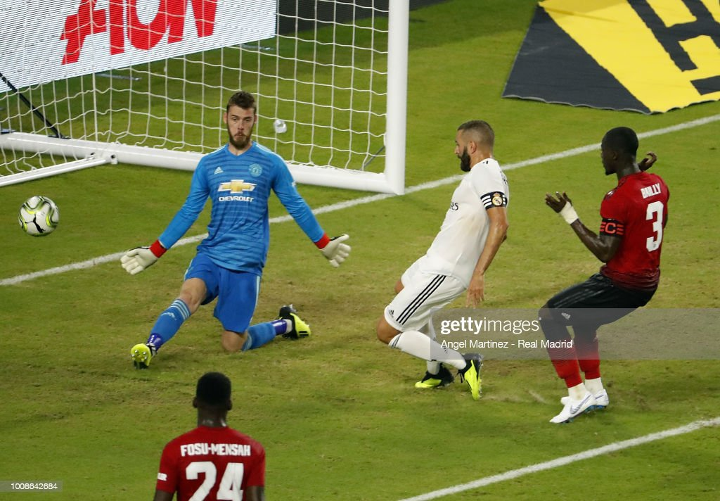 Karim Benzema of Real Madrid scores his team's first goal past David de Gea of Manchester United during the International Champions Cup 2018 match between Manchester United and Real Madrid at Hard Rock Stadium on July 31, 2018 in Miami, Florida.