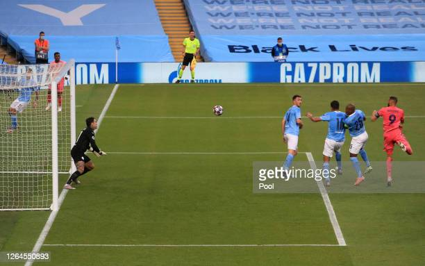 Karim Benzema of Real Madrid scores his team's first goal past Ederson of Manchester City during the UEFA Champions League round of 16 second leg...