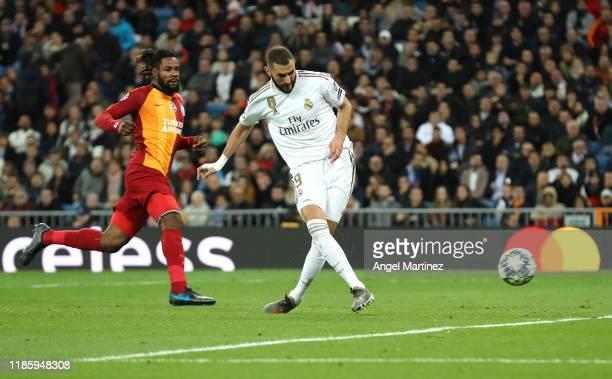 Karim Benzema of Real Madrid scores his team's fourth goal during the UEFA Champions League group A match between Real Madrid and Galatasaray at...