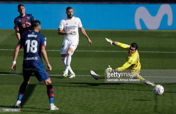 Karim Benzema of Real Madrid scores his team's second goal during the La Liga Santander match between Real Madrid and SD Huesca at Estadio Santiago...