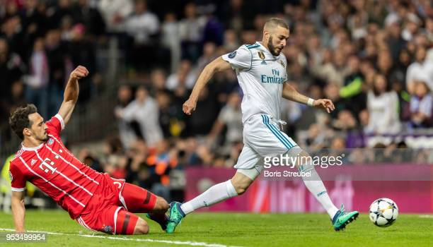 Karim Benzema of Real Madrid scores his team's second goal during the UEFA Champions League Semi Final Second Leg match between Real Madrid and...