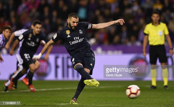 Karim Benzema of Real Madrid scores his team's second goal from a penalty during the La Liga match between Real Valladolid CF and Real Madrid CF at...