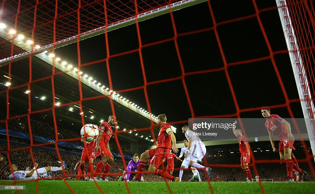 Karim Benzema of Real Madrid scores his team's third goal during the UEFA Champions League Group B match between Liverpool and Real Madrid CF on October 22, 2014 in Liverpool, United Kingdom.
