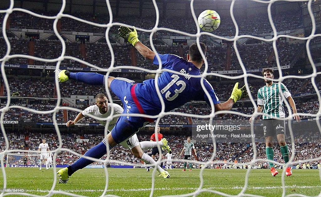 Karim Benzema of Real Madrid scores his team's third goal past Antonio Adan of Betis during the La Liga match between Real Madrid CF and Real Betis Balompie at Estadio Santiago Bernabeu on August 29, 2015 in Madrid, Spain.