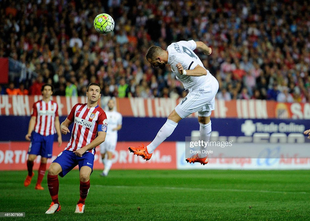 Karim Benzema of Real Madrid scores Real's opening goal during the La Liga match between Club Atletico de Madrid and Real Madrid at Vicente Calderon Stadium on October 4, 2015 in Madrid, Spain.