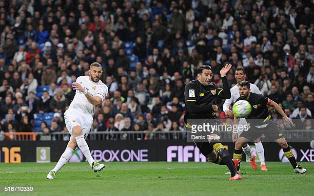 Karim Benzema of Real Madrid scores Real's opening goal during the La Liga match between Real Madrid CF and Sevilla FC at Estadio Santiago Bernabeu...