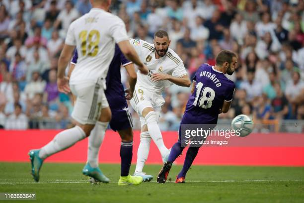 Karim Benzema of Real Madrid scores the first goal to make it 10 during the La Liga Santander match between Real Madrid v Real Valladolid at the...