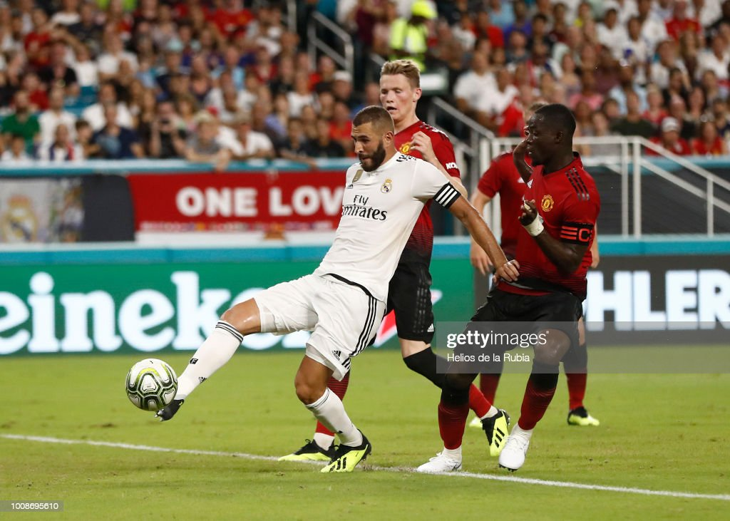 Karim Benzema of Real Madrid scores the goal scoring during the International Champions Cup 2018 match between Manchester United and Real Madrid at Hard Rock Stadium on July 31, 2018 in Miami, Florida.