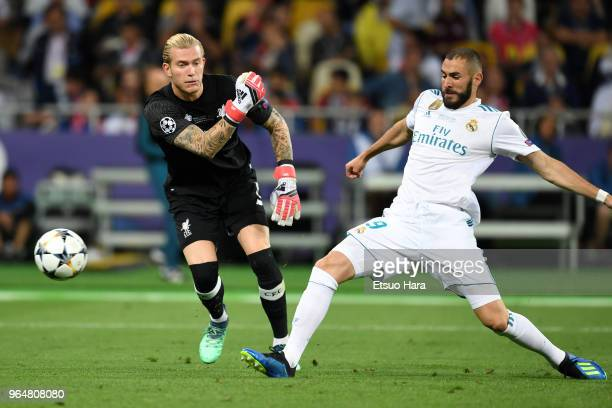 Karim Benzema of Real Madrid scores the opening goal by intercepting the ball thrown by Loris Karius of Liverpool during the UEFA Champions League...