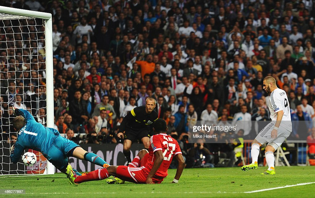 Karim Benzema of Real Madrid scores the opening goal during the UEFA Champions League semi-final first leg match between Real Madrid and FC Bayern Muenchen at the Estadio Santiago Bernabeu on April 23, 2014 in Madrid, Spain.