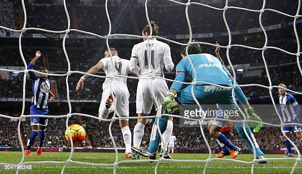 Karim Benzema of Real Madrid scores the opening goal past German Lux of Deportivo La Coruna during the La Liga match between Real Madrid CF and RC...
