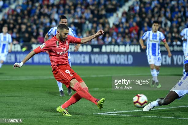 Karim Benzema of Real Madrid scores their first goal during the La Liga match between CD Leganes and Real Madrid CF at Estadio Municipal de Butarque...