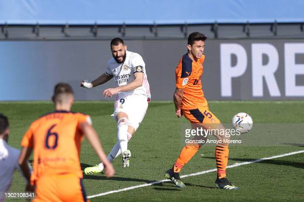 Karim Benzema of Real Madrid scores their side's first goal during the La Liga Santander match between Real Madrid and Valencia CF at Estadio Alfredo...