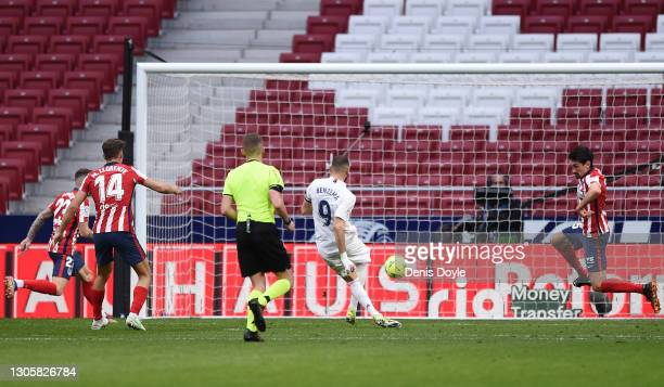 Karim Benzema of Real Madrid scores their side's first goal during the La Liga Santander match between Atletico de Madrid and Real Madrid at Estadio...