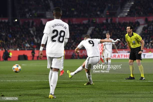 Karim Benzema of Real Madrid scores to make it 20 during the Copa del Quarter Final match between Girona and Real Madrid at Montilivi Stadium on...