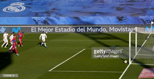 Karim Benzema of Real Madrid scoring his team's second goal during the La Liga Santander match between Real Madrid and Elche CF at Estadio Alfredo Di...