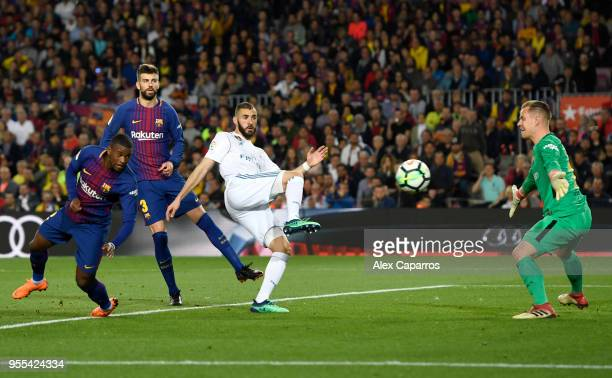 Karim Benzema of Real Madrid shoots as MarcAndre ter Stegen of Barcelona attempts to save during the La Liga match between Barcelona and Real Madrid...